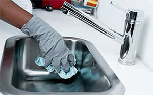rubber glove in small sink