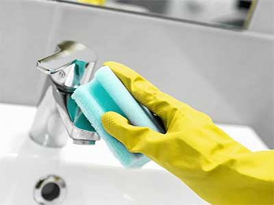 rubber glove and tap
